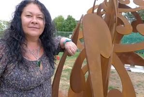 Lonnie Jutchinson with her sculpture. Photo / Supplied