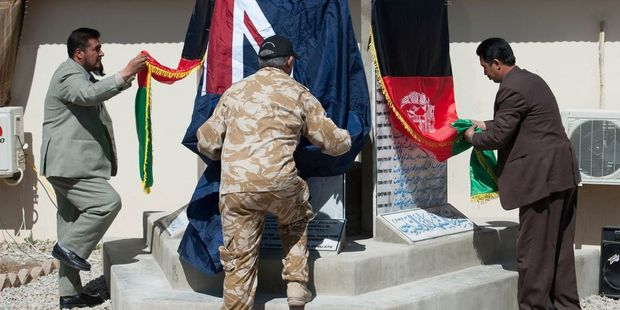 Loading The New Zealand flag is lowered for the final time at Kiwi Base in Bamiyan. Photo / NZ Defence Force/Supplied