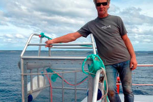 Shark Dive New Zealand director Peter Scott with his new single-man Perspex shark cage. Photo / Otago Daily Times