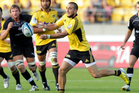 Andre Taylor of the Hurricanes passes during the round seven Super Rugby match between the Hurricanes and the Kings. Photo / Getty Images.