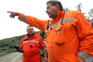 Rural fire officer Porky Sexton and Wairarapa principal rural fire officer Phill Wishnowsky discuss the fire. Photo / Wairarapa Times- Age