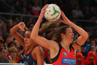 Geva Mentor of the Vixens and Irene van Dyk of the Magic compete for the ball. Photo / Scott Barbour, Getty Images