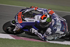 MotoGP rider Jorge Lorenzo of Spain steers his motorbike during the 4th Free Practice session a day ahead of Sunday's Qatar MotoGP, at the Losail International Circuit, Saturday, April 6, 2013. (AP Ph