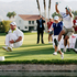 Inbee Park, second from right, of South Korea, celebrates by jumping into Poppy's Pond with caddie Brad Beecher, left, after winning the LPGA Kraft Nabisco Championship golf tournament in California. Photo / AP