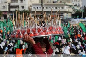 A Palestinian boy sells candy apples during a Hamas rally celebrating a new memorial center in Gaza City.  Photo / AFP