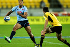 Israel Folau of the Waratahs looks to step Conrad Smith of the Hurricanes during the round eight Super Rugby match between the Hurricanes and the Waratahs. Photo / Getty Images.