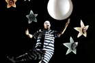 In The Addams Family musical, Fester floats above the stage of Sydney's Capitol Theatre. Photo / Jeff Busby