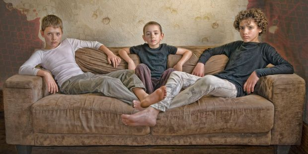 Three Boys on a Couch by Cathy Franzoi.