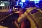 A still from a cellphone video showing a scuffle between a woman and a police officer. Photo / Supplied