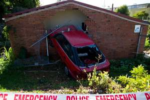 Structural engineers are assessing the damage to the council flat in Papatoetoe after a car smashed into it.  Photo / Greg Bowker