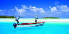 Butch Leone directs a visitor on how to fly-fish in the lagoon at Aitutaki in the Cook Islands. Photo / Supplied