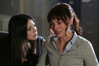Michelle Trachtenberg as the stalker and Beth Riesgraf as Spencer's girlfriend Maeve on 'Criminal Minds'. Photo / Supplied