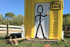 Cluck, cluck, cluck - humour on a farm shed in Waitoki. Photo / Supplied