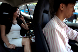 Expensive cars and chauffeurs are all part of the basics for newly rich Vietnamese. Photo / Getty Images