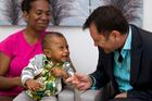 Benjamin Cyrus with his mother Madline and surgeon Dr Justin Mora after the sight-saving surgery. Photo / Michael Craig