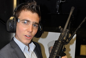Jack Tame says that regardless of your stand on guns, firing an assault rifle is a buzz. Photo / Supplied
