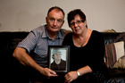 John and Jeanette McClean with a photo of their teacher son Tony, who perished. Photo / Dean Purcell