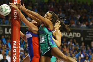 Geva Mentor of the Vixens (right) and Cathrine Latu of the Mystics scrap for the ball. Debate rages about the roughness of the game. Photo / Getty Images