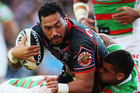 South Sydney players stop Warrior Feleti Mateo during their clash at Mt Smart Stadium last weekend. The Rabbitohs won 24-22.  Photo / Getty Images