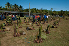 Piles of food outside the Hakupu Village hall will be distributed to families who made a donation to the ceremony. Photo / Jeff Evans