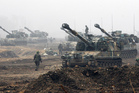 South Korean Marine K-55 self-propelled howitzers are on positions during an exercise against possible attacks by North Korea. Photo / AP