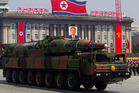 A North Korean vehicle carrying a missile passes by during a mass military parade in Pyongyang's Kim Il Sung Square. Photo / Ap