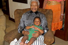 Nelson Mandela holding his great grandson Zen Manaway at home in Johannesburg, South Africa.Photo / AP