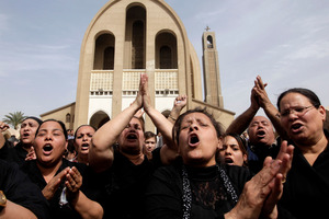 Egyptian Christians chant anti-Muslim Brotherhood slogans at the Saint Mark Coptic Cathedral yesterday.  Photo / AP