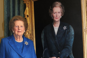 Former Prime Minister Margaret Thatcher, stands next to her portrait painted by artist Richard Stone, at 10 Downing St. Photo / AP