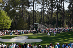 Even practice rounds are drawing big crowds as Masters fever grows. Photo / AP