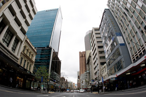 Queen St in Auckland is dwarfed by high-rise towers. Photo / Richard Robinson