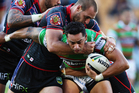 John Sutton of the Rabbitohs is hit hard by Simon Mannering during the round 5 NRL match between the New Zealand Warriors and the South Sydney Rabbitohs. Photo / Getty Images.
