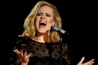 Adele performing at the Grammy Awards in Los Angeles. Photo/AP