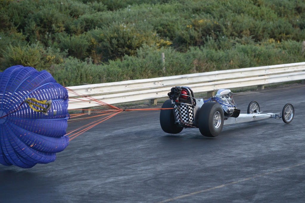 The parachute and barking area bumps pick up all four wheels on Dave Mason's  front engine dragster. COLIN SMITH PHOTO