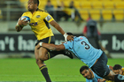 Julian Savea on the burst against the Waratahs. Photo / Getty Images