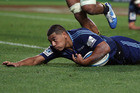 Charles Piutau of the Blues dives over to score. Photo / Getty Images