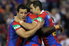 James McManus, right, of the Newcastle Knights celebrates a try with team mates. Photo / Getty Images