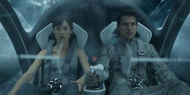Loading Olga Kurylenko and Tom Cruise in Oblivion. Photo/supplied