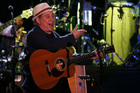 Paul Simon in concert. Photo/Getty Images