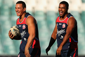 Sonny Bill Williams and teammate Michael Jennings share a laugh during a Sydney Roosters NRL training session. Photo /Getty Images