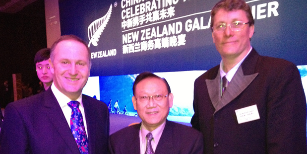 Sir Richard Taylor, right,  in Beijing with his 'twin' Fred Tang and Prime Minister John Key.  Photo / Audrey Young