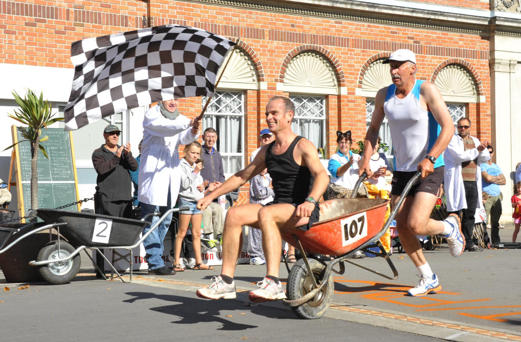 wta060413ckbarrow11.JPG Gladstone to Carterton Wheelbarrow Race, Gladstone Domain, Saturday, winners Gavin Graham and Mark Eagle cross the finishing line in the race from Gladstone to Carterton.