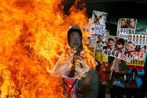 South Korean protesters burn effigies of North Korean leader Kim Jong-Un, and late leaders Kim Jong Il and Kim Il Sung at an anti-North Korea protest in Seoul. Photo / AP