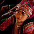 An ethnic Lisu girl in traditional tribal attire sits in village school in Ywar Thar Yar village, in a region known for drug smuggling and a decades-old insurgency, in Myanmar. Photo / AP