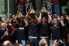 CJ Bruton, Mika Vukona and Dillon Boucher of the New Zealand Breakers hold up their Championship trophys from the last three years during a homecoming celebration. Photo / Getty Images.