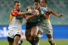 Israel Folau of the Waratahs is tackled during the round 10 Super Rugby match between the Waratahs and the Chiefs. Photo / Getty Images.