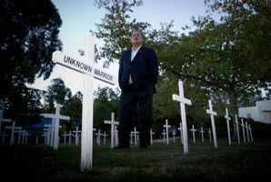Maitlind Manning, from the Waipawa RSA, pictured among a field of crosses - some of which have been stolen. Photo / Glenn Taylor