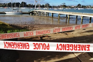 The scene at Tamai River as police divers prepare to investigate reports of a submerged car. Photo / Greg Bowker