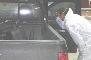 The forensic team examines the vehicle recovered from the scene. Photo / Supplied