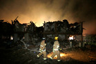 Firefighters check a destroyed apartment complex near the fertilizer plant that exploded earlier in West, Texas. Photo / AP